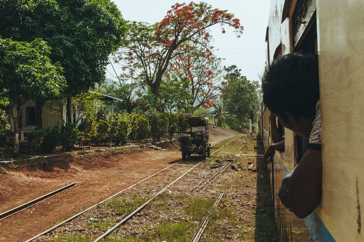 Getting some air hanging out the window in Myanmar. - IG @LostBoyMemoirs (Photos taken on Canon 650D Rebel T4i, edited in Lightroom.) People People Watching People Photography Streetwise Photography Street Photography ASIA Myanmar Burma Myanmar Culture Myanmarphotos Adventure Backpacking Culture And Tradition Cultures Exploration Travel Destinations Train Train - Vehicle Transportation Rail Transportation Track Railroad Track Tree Public Transportation Plant Mode Of Transportation Real People One Person Day Lifestyles Nature Architecture Travel Outdoors Land Vehicle Waiting My Best Photo The Art Of Street Photography