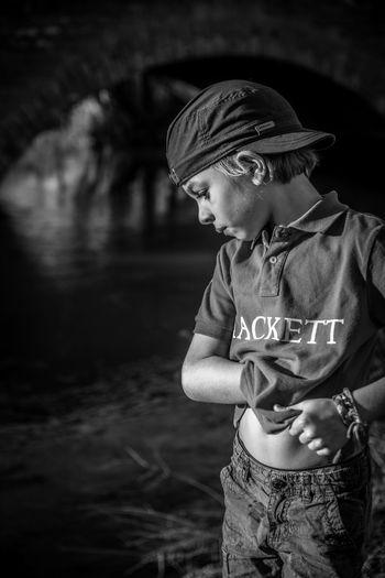 Boy standing in water