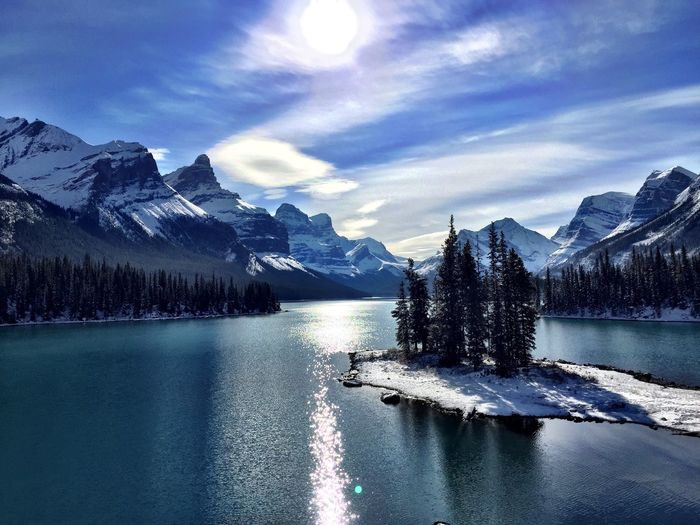 Mountain Range Spirit Island Canadian Rockies  Canada IPhoneography Water Mountain Sky Scenics - Nature Beauty In Nature Cloud - Sky Mountain Range Nature Waterfront Tranquil Scene Lake Tree Tranquility Winter Reflection Cold Temperature Snow Day Plant No People