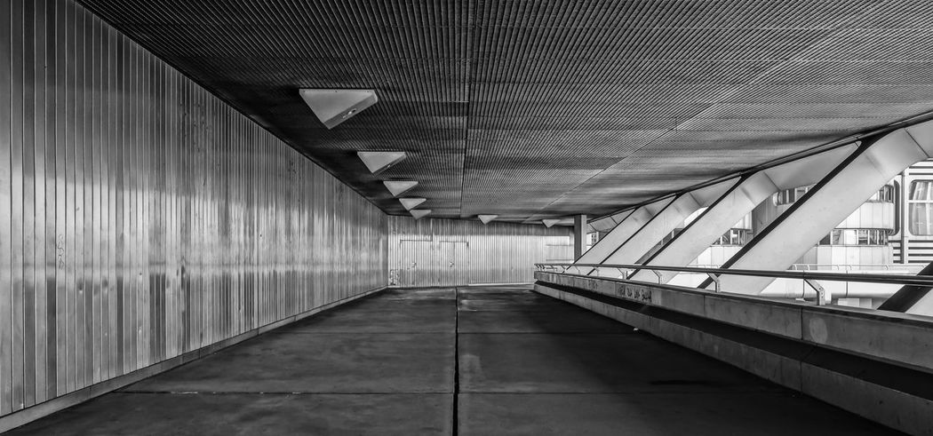 Absence Architectural Column Architectural Feature Architecture Bridge Building Built Structure Ceiling Corridor Diminishing Perspective Empty Flooring Fußgängerbrücke Illuminated Long Metal Metallic No People Pedestrian The Way Forward Tunnel Vanishing Point Walkway