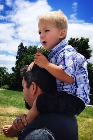 Best spot Shoulders Icecream Real People Boys Leisure Activity Childhood Casual Clothing Family With One Child Sky Father Family Son Lifestyles Grass