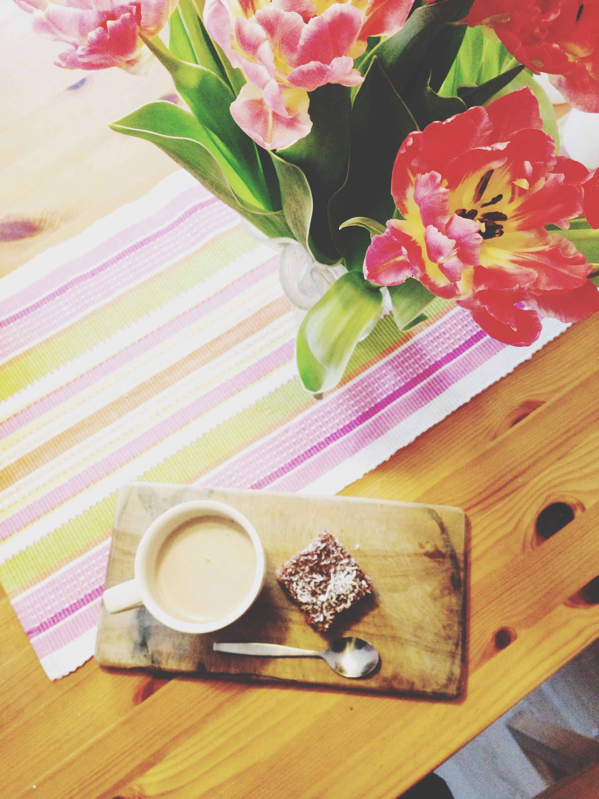 table, indoors, freshness, food and drink, still life, high angle view, drink, wood - material, flower, refreshment, coffee cup, vase, spoon, food, wooden, plate, directly above, coffee - drink, cup, saucer
