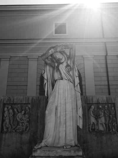 Statue against building