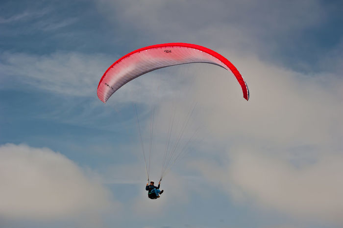 Adventure Cloud - Sky Day Exhilaration Extreme Sports Flying Gliding Leisure Activity Lifestyles Low Angle View Men Mid-air Nature One Person Outdoors Parachute Paragliding People Real People Sky Skydiving Sport Stunt Person Unrecognizable Person