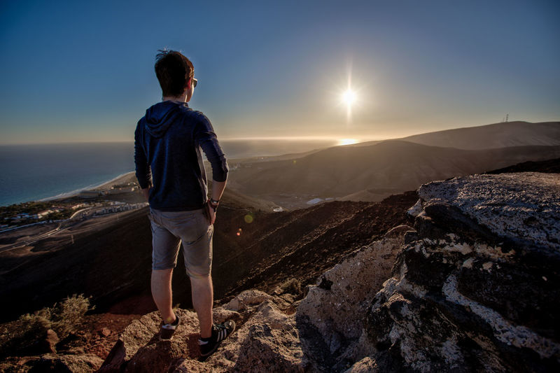 Thinking men Fuerteventura Thinking Adult Beauty In Nature Full Length Hiking Landscape Lifestyles Looking At View Men Mountain Mountains Nature One Person Outdoors Real People Rear View Scenics Sky Standing Sunset