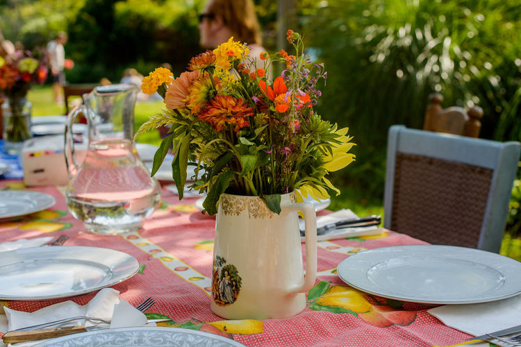 Summer Dinner table Flower Freshness Front Or Back Yard Outdoors Place Setting Plate Table Vase