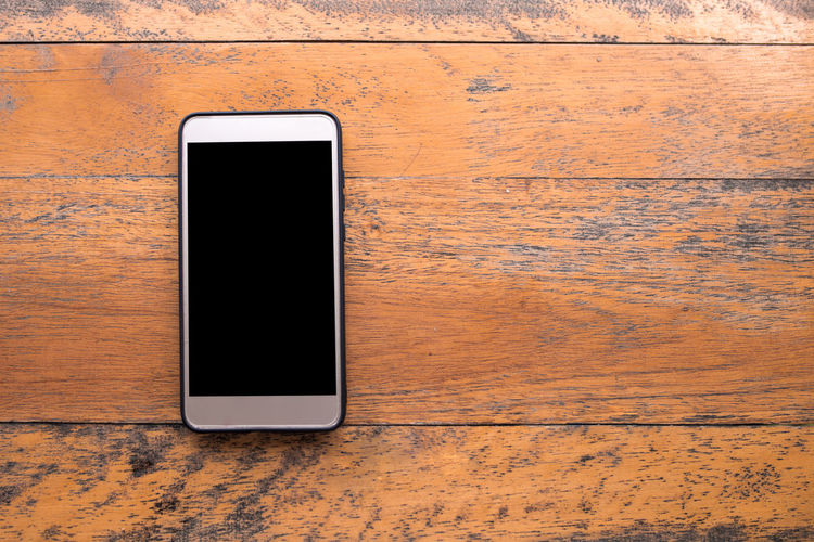 Directly above view of smart phone on table