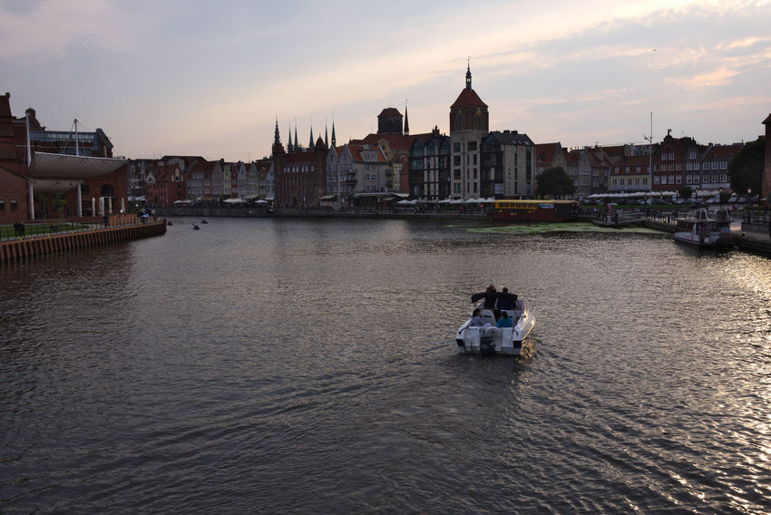 Old Town from Motlawa Calm Old Town Tourist Architecture Boat Bridge Building Exterior City Motlawa River Motława Outdoors Real People River Sky Sunset Tourism Water Waterfront