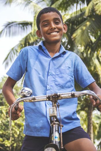 Portrait of a schoolboy on bicycle
