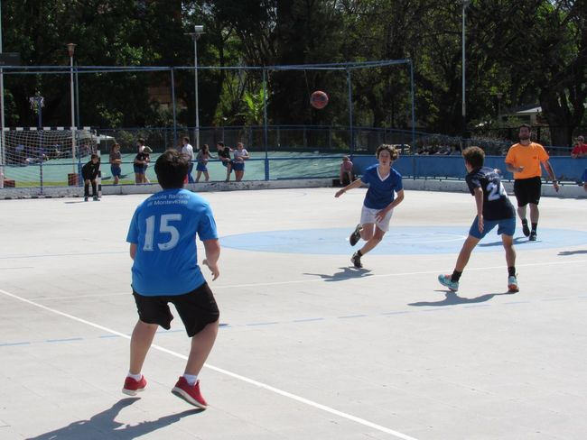 Going to the Goal Handball Match Sport Group Of People Real People Playing Competition Men Child Full Length Lifestyles Nature People Fence Leisure Activity Day Tree Crowd Sunlight Teamwork Cooperation Outdoors