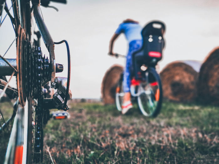 Close-up of bicycle on field