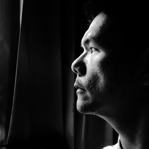 Close-up of thoughtful man at home