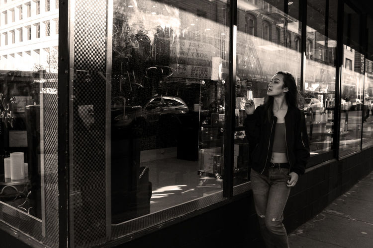 Reflection of woman on mirror at store