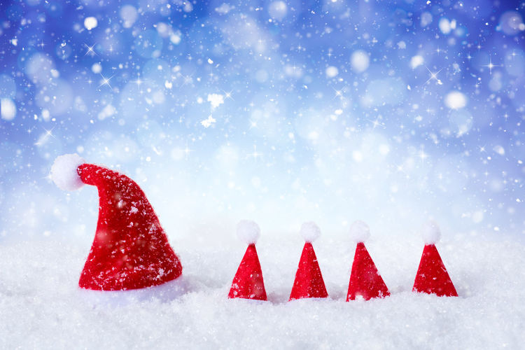 View of red christmas ornaments on snow