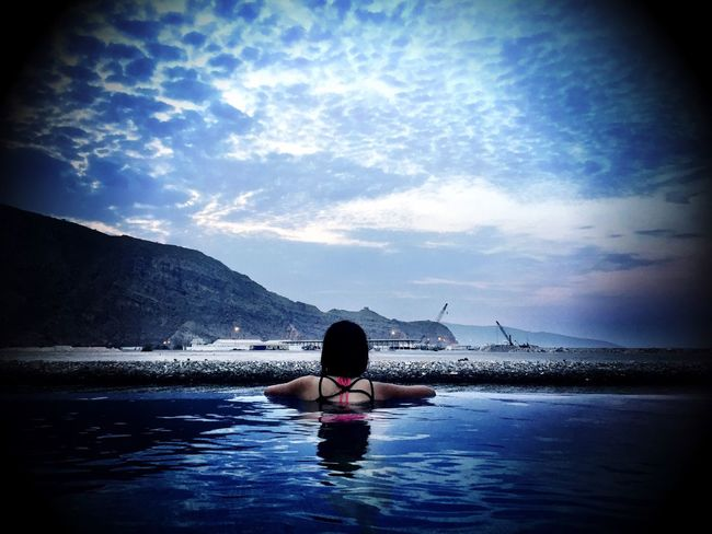 Indulging the moment Oman Oman_photography Musandam Musandam Oman Infinity Infinity Pool Skyporn Taking Photos Taking Pictures Taking Photos Of People Relaxing Relaxation Check This Out! IPhoneography After Sunset After Sunset Sky