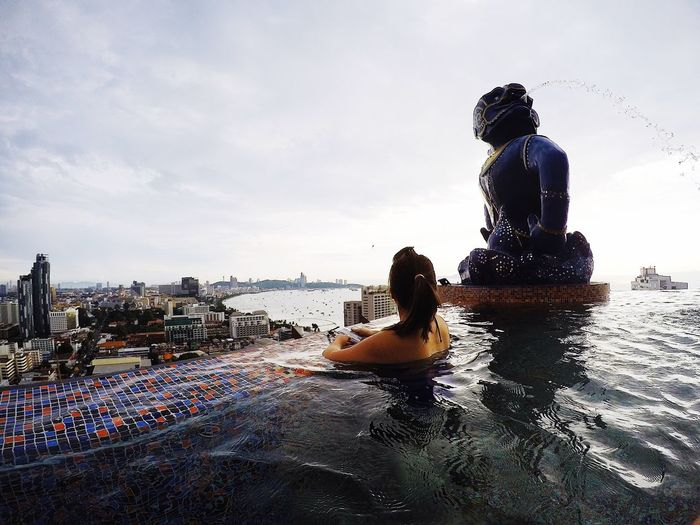 This could easily be one of the TOP 10 infinity pools City View  Skyline Pool View Hotel View Pattaya Thailand Infinity Pool Water Sky Silhouette Real People One Person Day Men