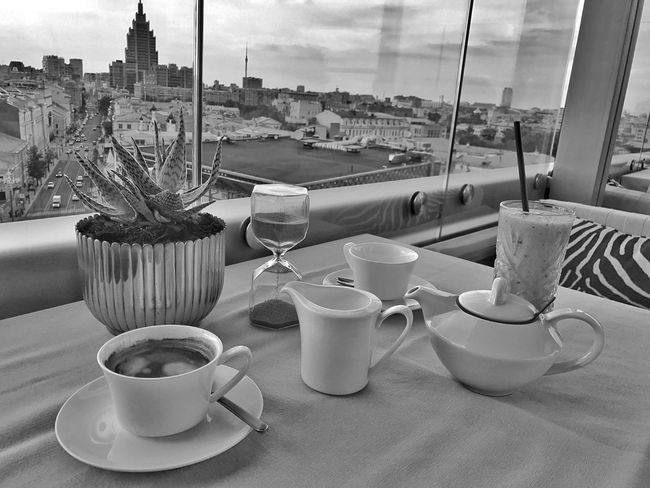 Moscow June 2018 Black&white Black And White Photography Lifestyle Building And Sky Buildings & Sky Moscow Chilling Panoramic View Urban Lifestyle Conversation Meeting Friends Drinks Drinking Glass Smoothie Tea Coffee Food And Drink Cup Drink Table Refreshment Mug Coffee Cup Architecture Glass City Spoon Coffee Sky No People