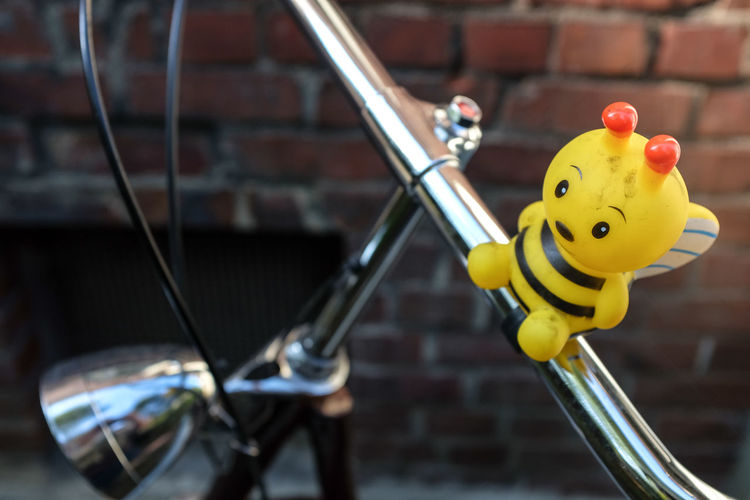 Bee on bicycle handlebars Bee Bicycle Bike Childhood Close-up Focus On Foreground Fun Handlebar Joy No People Outdoor Play Equipment Outdoors Toy Vibrant Color Yellow