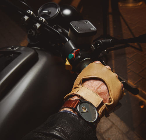 Close-up of hand of motorcyclist in protective glove Arm Bike Biker Cafe Racer Cafe-racer Close-up Hand Handlebar Human Hand Lifestyles Male Man Mode Of Transport Moto Motorbike Motorcycle Motorcyclist People Protective Glove Subculture Throttle Transportation Vehicle Watch