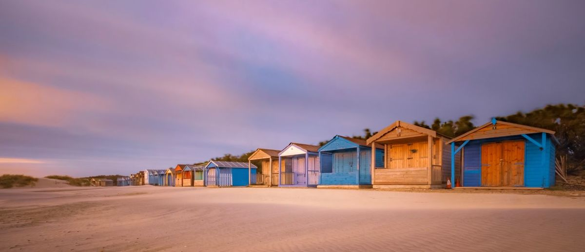 Sunset Beach Huts Land Architecture Built Structure Building Exterior Beach Sand Cloud - Sky Beach Hut Sky Nature Hut Sunset Building House Scenics - Nature Beauty In Nature No People Multi Colored Tranquility Outdoors