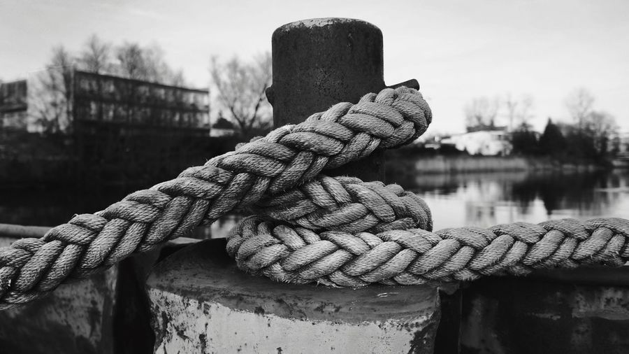 Close-up of rope tied to bollard