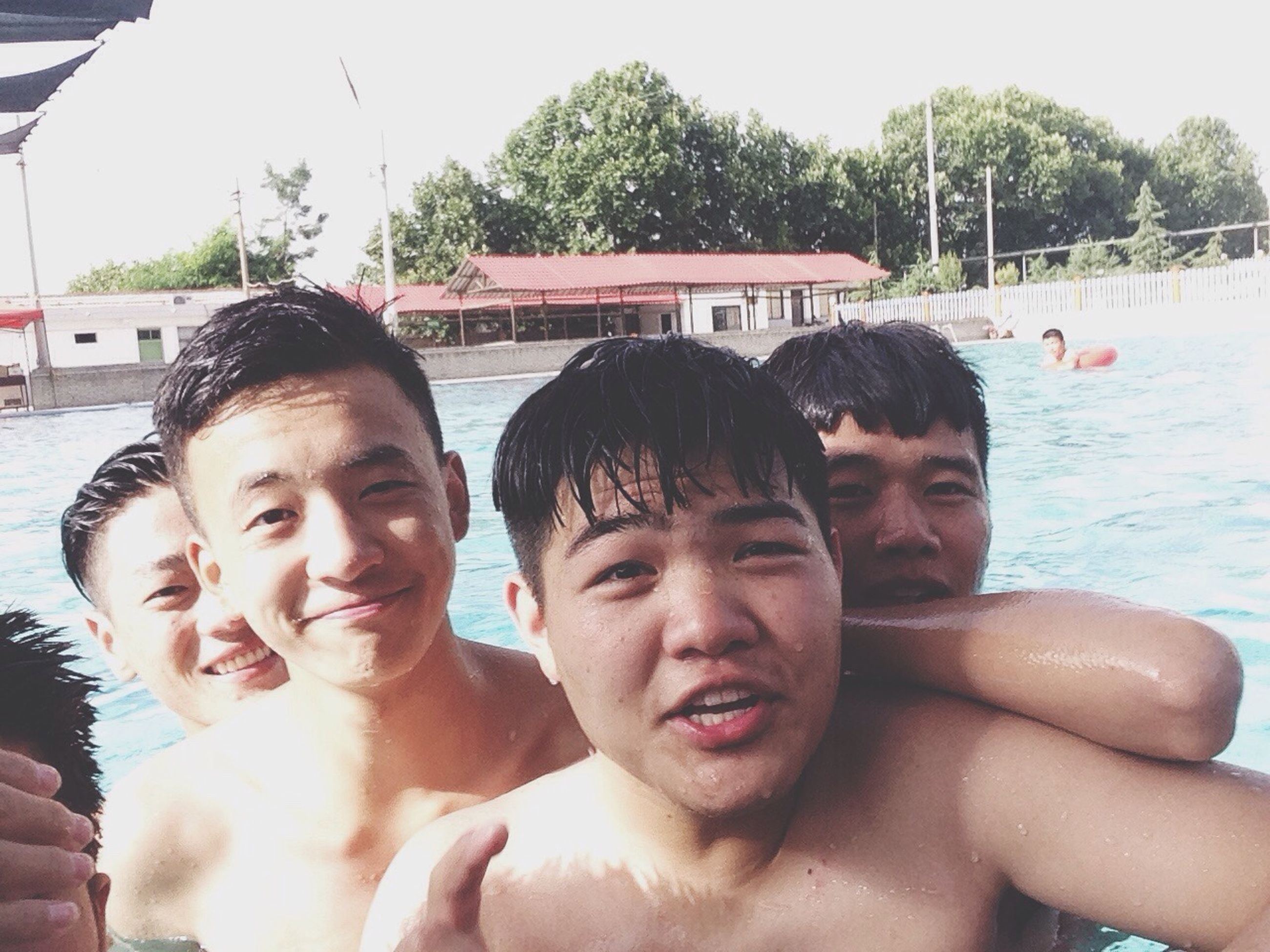 togetherness, bonding, lifestyles, person, leisure activity, portrait, love, happiness, looking at camera, smiling, young men, boys, friendship, childhood, water, family, elementary age, young adult