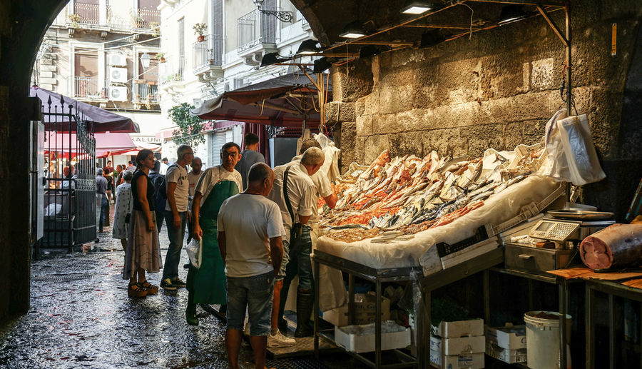 fish market Catania, Sicily, Italy Market Real People Retail  Market Stall Street Market For Sale Food Fish Market Catania Sicily Street Streetphotography Street Photography Travel Light And Shadow Italy Food And Drink Fish