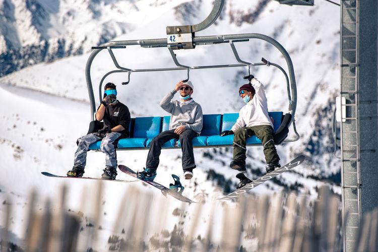People sitting on snow
