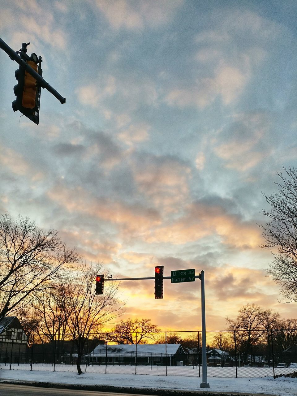 sky, bare tree, cloud - sky, traffic signal, sunset, traffic light, no people, red light, stoplight, road sign, cold temperature, signal, winter, outdoors, low angle view, tree, nature, day