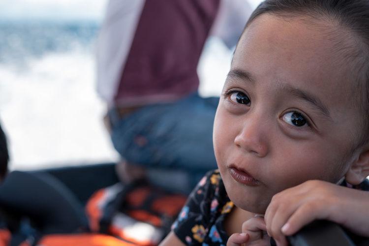 Portrait of a sad asian child outdoor.