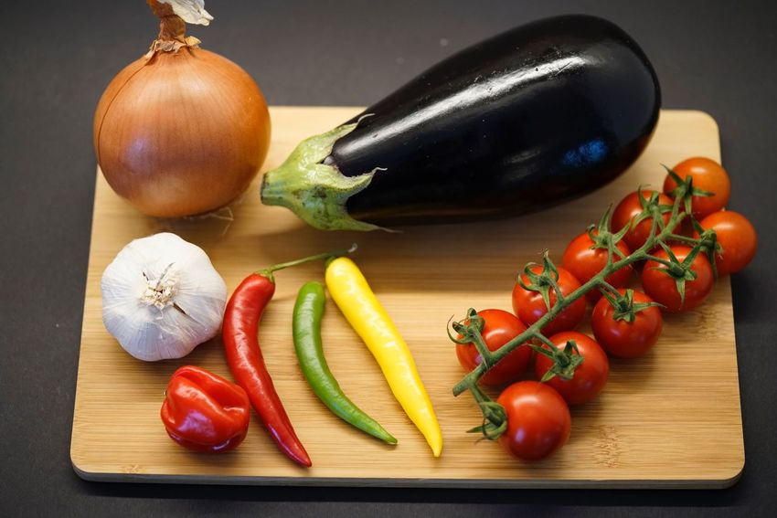 Vegetable Food And Drink Food Table Tomato Still Life Freshness Healthy Eating Indoors  Red Bell Pepper Bell Pepper Red Garlic Spice Cutting Board No People Raw Food Ingredient Variation Close-up
