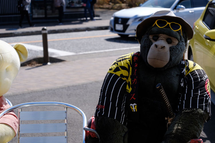 Gorilla toy on chair in city
