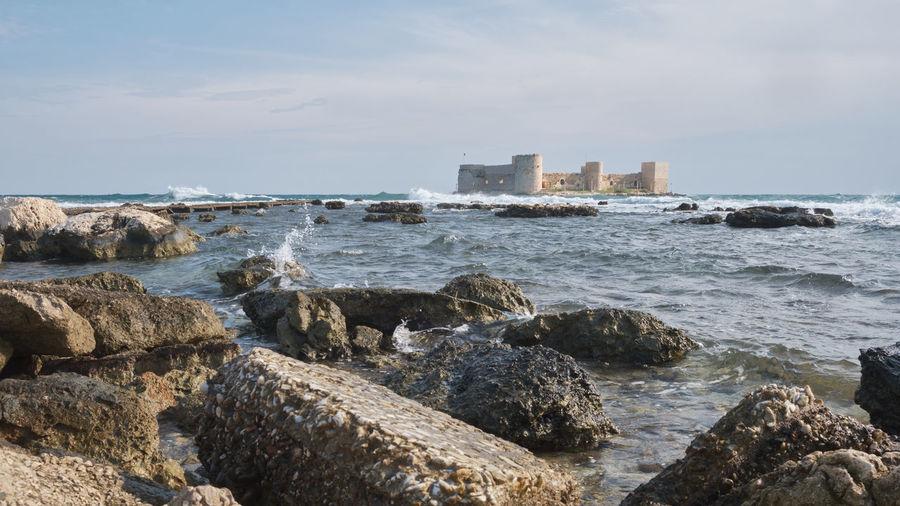 Ancient fortress kizkalesi or maiden castle on island in mediterranean sea. mersin province, turkey