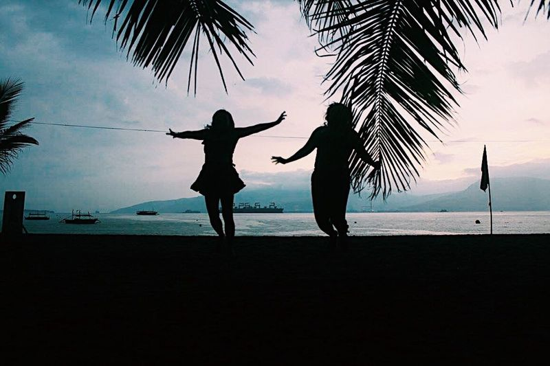 Palm Tree Beach Silhouette Sea Water Two People Sky Nature Men Outdoors Horizon Over Water Scenics Women Togetherness Beauty In Nature Standing Tree Sand Real People Lifestyles Blue Jump Jumpshot Philippines Subic