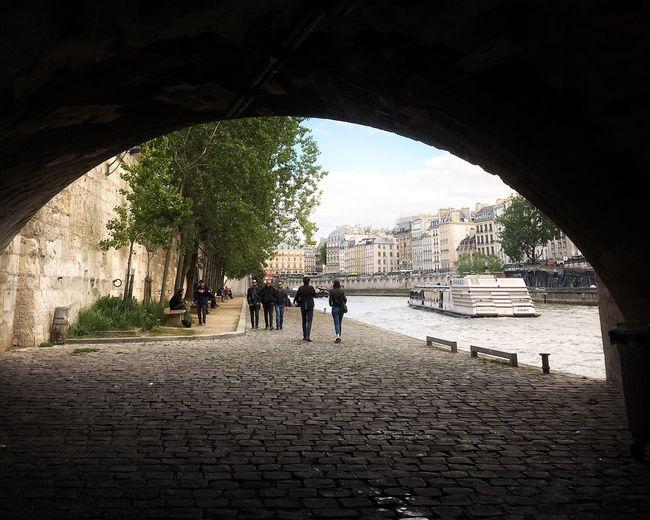 People walking in tunnel