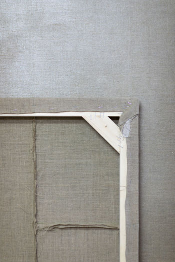 Close-up of picture frame hanging on wall