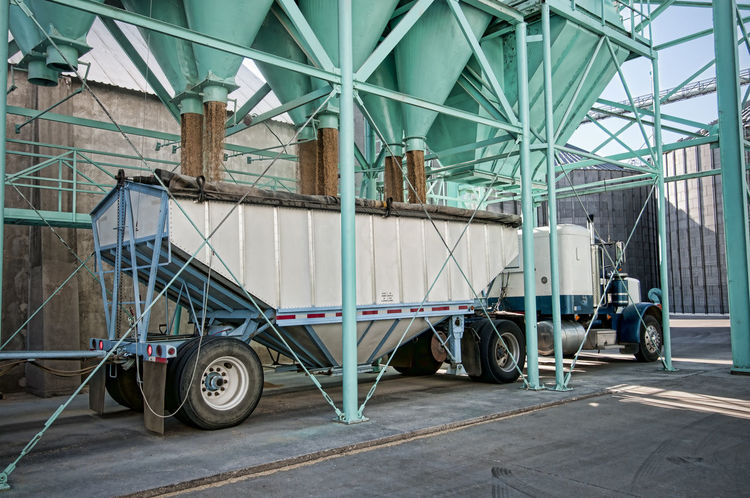 Rice processing plant Agriculture Container Delivery Food Delivery Truck Equipment Filling Up The Tank Food Horizontal Composition Loading Zone Mode Of Transport No People Processing Plant Structures And Architecture Transportation Truck Trucking