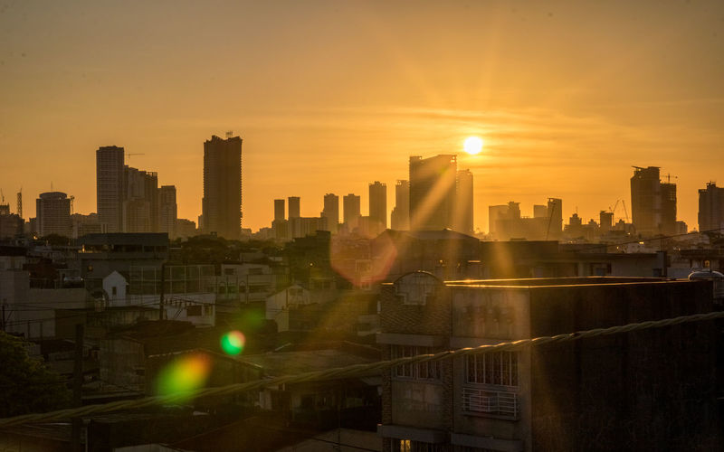 StarBurst Flare Architecture Building Exterior City Cityscape Landscape Lens Flare Modern Nature No People Office Building Exterior Orange Color Outdoors Sky Skyscraper Solar Flare Starburst Sun Sunbeam Sunlight Sunset Urban Skyline Architecture The Architect - 2018 EyeEm Awards