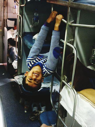 Portrait of smiling boy sitting in bus