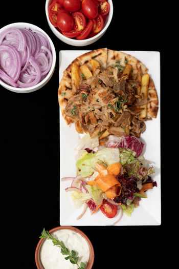 Greek gyros Cuisine Greek Gyros Meal Pork Salad Black Background Close-up Directly Above Food Food And Drink Freshness Greek Food High Angle View Meat No People Onions Pita Bread Ready-to-eat Tomatoes Tzatziki