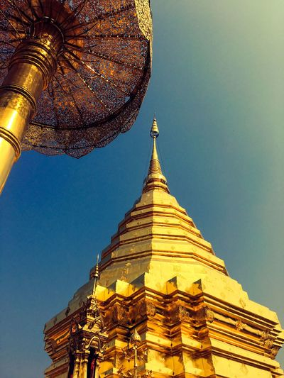Religion Spirituality Architecture Place Of Worship Gold Colored Built Structure Pagoda Building Exterior Low Angle View Travel Destinations Gold Clear Sky Ancient History Travel Sky No People Statue Outdoors Day Thailand Temple
