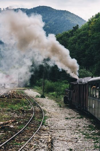 Smoke emitting from train on railroad track