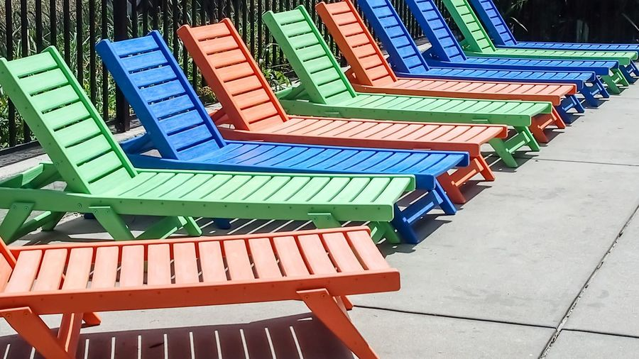 colorful pool lounging chairs in a row Bradleywarren Photography Room For Text Room For Copy Copy Space Copyspace Backgrounds Background Bradley Olson Empty Chairs Lounge Chair Poolside Sunbathing Colorful Summer Summertime South Carolina Tourism Tourist Attraction  Tourist Destination Vacations Multi Colored Architecture Repetition Arrangement Various In A Row Order LINE Collection Side By Side