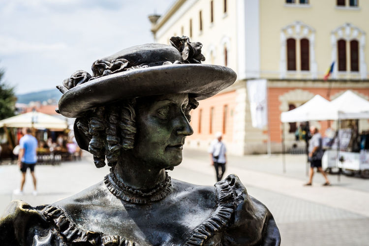 Portrait of a woman Statue Statues Statues And Monuments Statues/sculptures Statues In The Park Woman Girl Lady Hat Portrait Portrait Of A Woman Monument History Historic Park Momument Sculpted Medieval Medieval Architecture MedievalTown Outdoors Outdoor Photography Summer Art Arts Culture And Entertainment