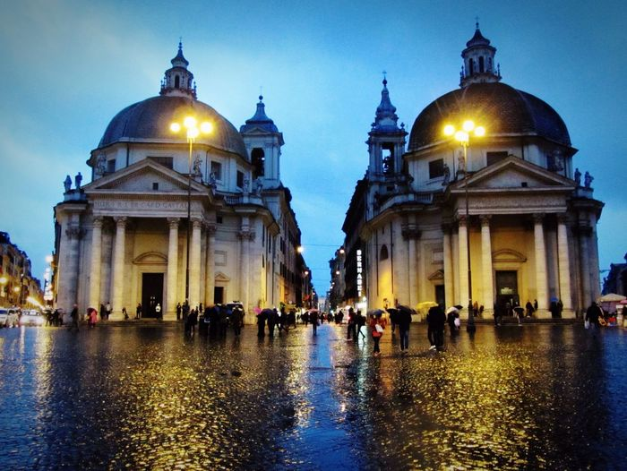 People at piazza del popolo against sky