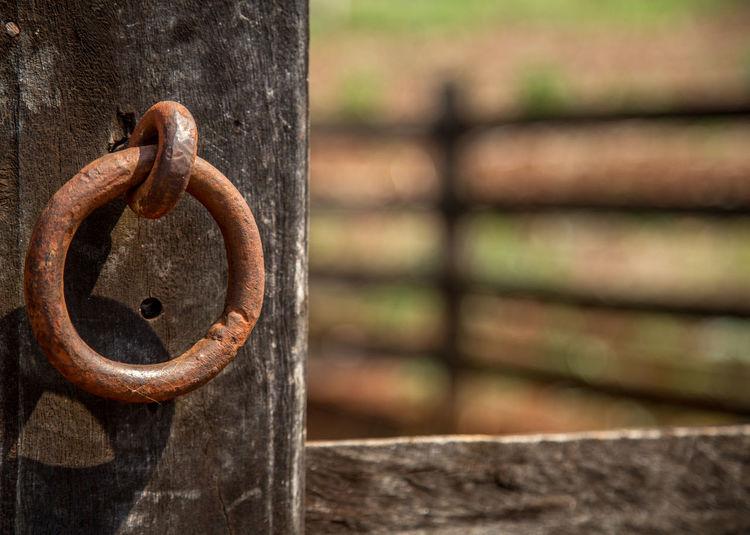 Close-up of rusty metal doorknocker