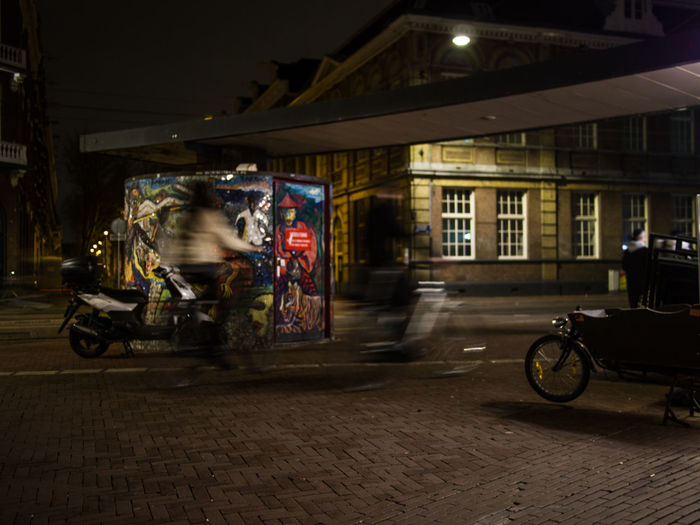 Transportation Architecture City Motion Street Mode Of Transportation Built Structure Building Exterior Night Blurred Motion Land Vehicle Illuminated Road Real People on the move Ride Outdoors Speed Rickshaw Riding