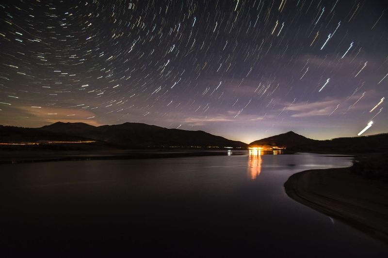 Startrails Night Star - Space Mountain Tranquil Scene Scenics Nature Water Tranquility Beauty In Nature Lake Outdoors Star Trail Astronomy Long Exposure Sky No People Mountain Range Landscape Galaxy Travel Destinations