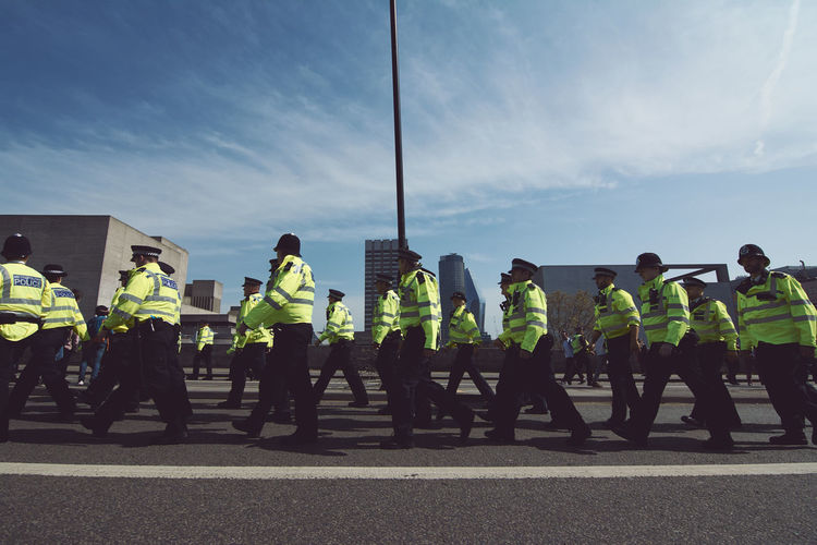 Extinction Rebellion - London 2019 Extinction Rebellion Protest Protesters London Real People Group Of People Clothing Sky Men Reflective Clothing Uniform Day Street City Occupation Safety Crowd Road People Full Length Standing Government Nature Protection Outdoors Responsibility