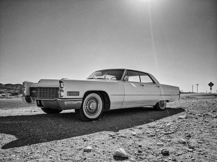 Vintage car on field against clear sky